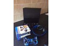 Sony PlayStation 4 500 GB + 2 Controllers + PlayStation 2.0 Wireless 7.1 Headset