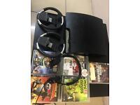 Playstation 3 slim black with 5 games & earphones
