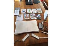 Nintendo Wii console, fit board and 7 games