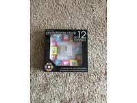 Photo frame clock with 12 frames new in box