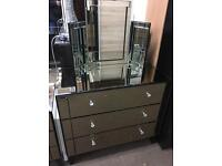 Mirrored dressing table with folding mirror