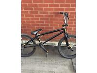 BMX bike in good condition, make Blanc. Cell , black with gold spindles and chain
