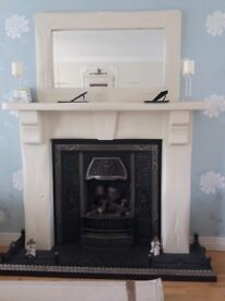 Wooden fireplace, mirror and inset