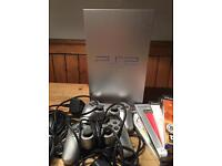 PlayStation 2 satin silver edition bundle