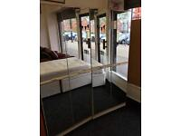 2 x double mirrored door wardrobes can deliver