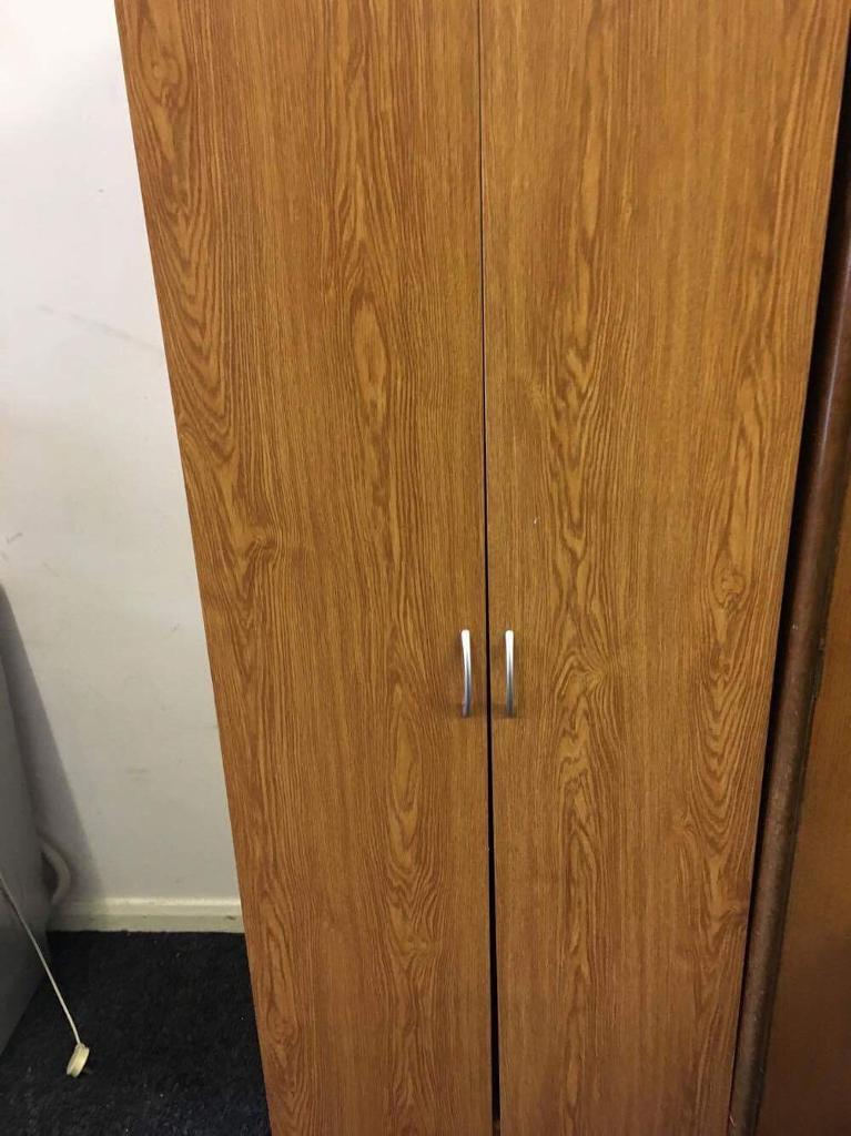Double teak effect wardrobe can deliver