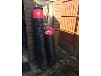 2 Heavy Duty Punch bags, one is 4ft and the other is 5ft 6