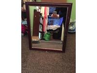 Small brown framed mirror