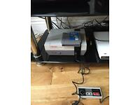Nintendo nes games console with 2 games