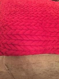 Red cushion and two cushion covers.