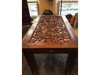 Carved top dining table