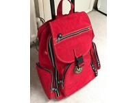 Red Kipling hand luggage carry on. Backpack too.