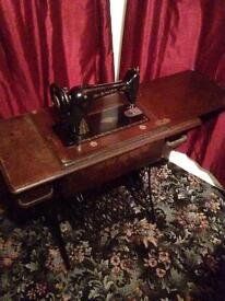 Singer sewing machine in treadle table