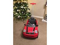 Ride on red Mini Cooper
