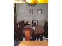 Table with 8 chairs (2 carvers and 6 chairs), Whitchurch.