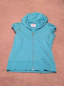 Blue short sleeved zip up top size 8