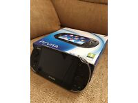 Mint condition PS Vita in box with cables for sale £100 ono