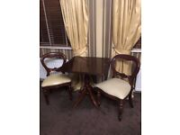 Mahogany table and set of two matching chairs