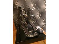 Brand new boxed heels size 5
