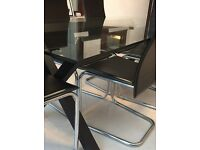 Contemporary glass table and chairs