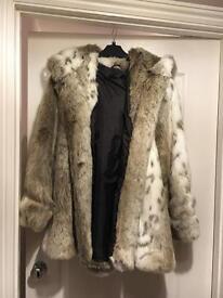 Lucy's boutique fur coat