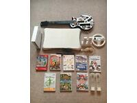 Nintendo Wii + All accessories + 8 games