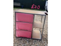 Pink storage draws and shelves