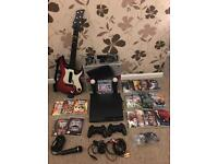 Playstation 3 250GB + PS Move + Guitar and mic + 19games
