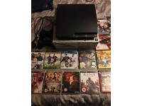 PlayStation 3 with 2 controllers & 24 games.