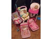 Dolls joblot baby carriers pushchairs and high feeding chair