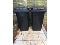 Two very large strong black wheelie bins