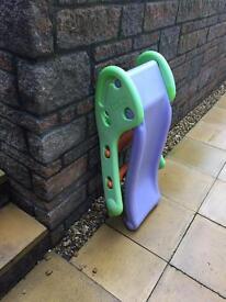 Child's Smoby slide in purple/green/orange