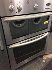 Indesit stainless steel undercounter integrated double oven