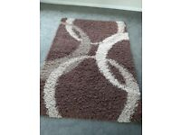 Brown and cream rug, nice condition.