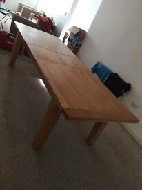Large solid oak table and eight cream leather chairs