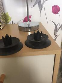 Two black metal candle stick holder s