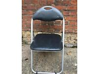 Folding metal chair with navy padded faux leather seat