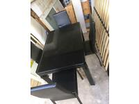 Leather and metal dining table with 4 chairs in good condition