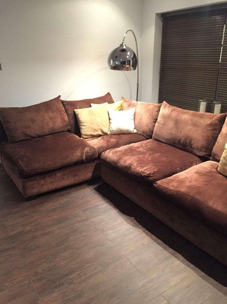 Corner Sofa (From Michael OConnorin Stokesley, North YorkshireGumtree - Corner sofa from Michael OConnor Brown material sofa with feather filling. The sofa comes in 2 parts that push together.The sofa is 3 years old but in good condition, it was £2,500 bought new