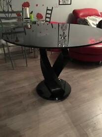 Twin Twirl Smoked Round Glass Dining Table