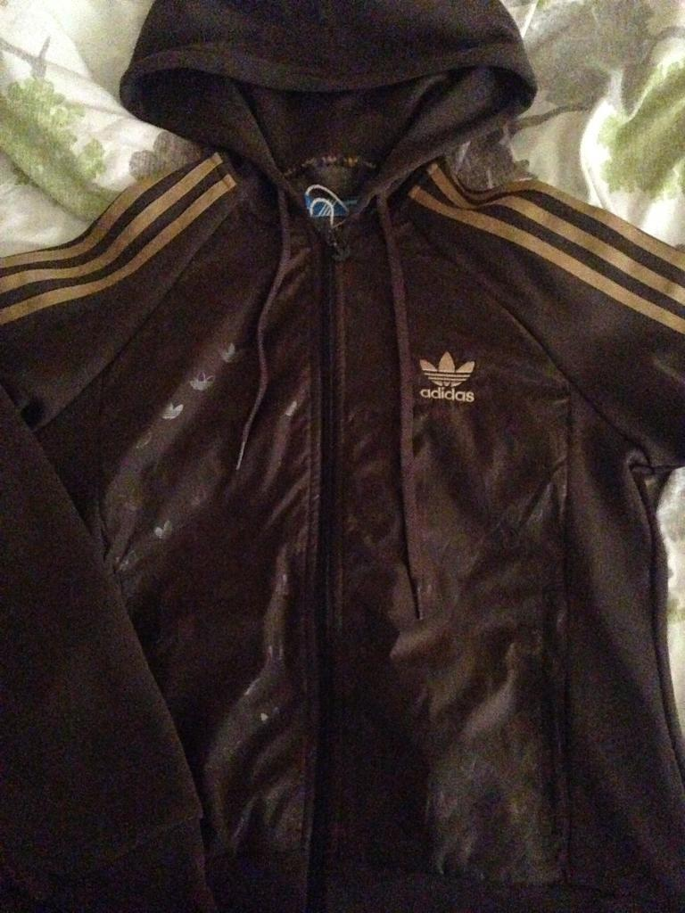 brown and gold adidas jacket