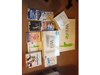 Nintendo Wii, Wii Fit, Wii Resort and 5 Games