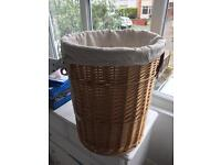 Wicker laundry basket with detachable bag.