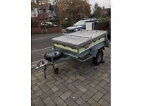 Box trailer with roof bars, spare wheel and cover