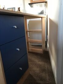 Dressing table with 3 drawers and a book case. 3 drawers in blue finish.
