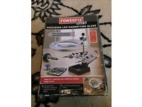 Powerfix magnifying glass with led light, soldering iron stand and crocodile clips.