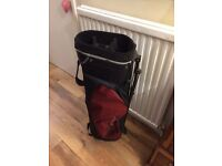 A Red and Black Golf Bag and Trolley
