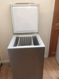 SILVER CHEST FREEZER IN GOOD WORKING CONDITION.