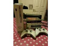 XBox 360 white with X2 controllers and 8 games