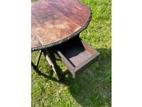 Hard wood drop leaf oval table